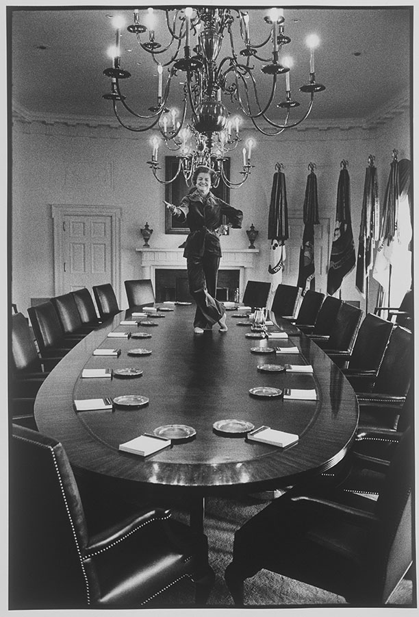 Betty Ford poses on the Cabinet Room conference table, January 19, 1977. Photo by David Hume Kennerly. di_00550