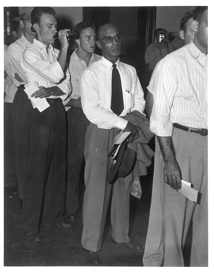 Heman Sweatt, the first African American student admitted to the University of Texas, registers for classes at the School of Law, 1950. di_01127