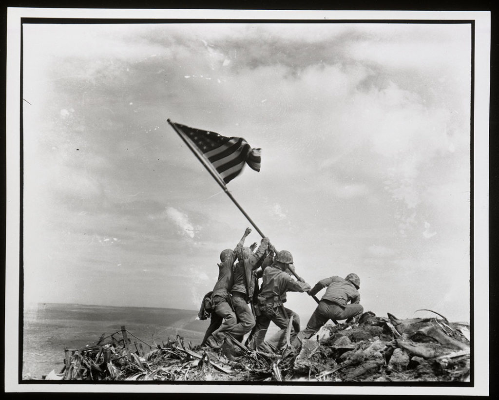Old Glory goes up on Mount Suribachi, Iwo Jima, February 23, 1945. Photo by Joe Rosenthal. di_01323