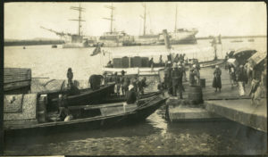Clipper ship and launches unloading, Haiphong, ca. 1900. ExxonMobil Historical Collection. di_03533