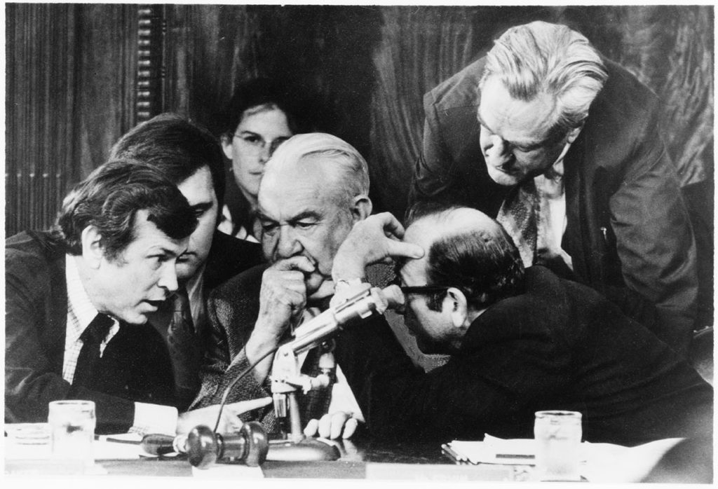 Howard Baker, Rufus Edmisten, and Sam Dash advising Committee Chairman Senator Samuel Ervin during the Watergate hearings, 1973. Photo by Wally McNamee. di_08149