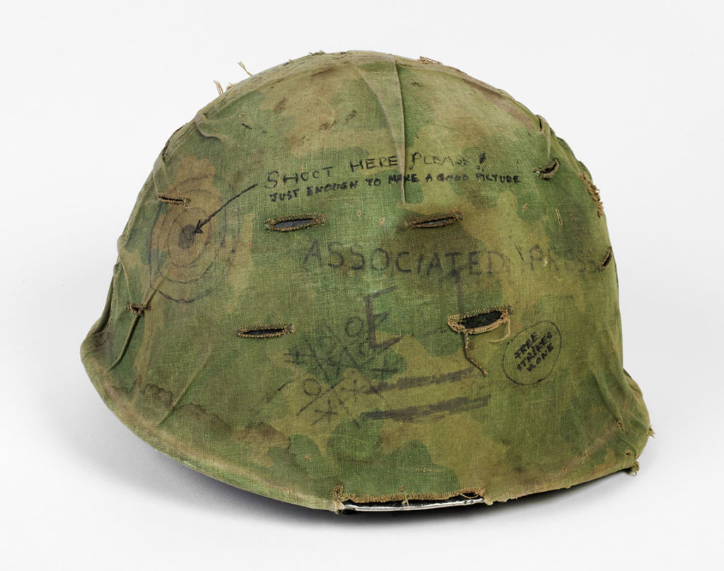 Combat helmet used by photojournalist Eddie Adams while covering the Vietnam War for the Associated Press, ca. 1966. di_09120
