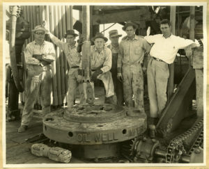 Six men posing with oil drill, Luling, Texas, ca. 1935. United North and South Development Company Album. e_enr_004