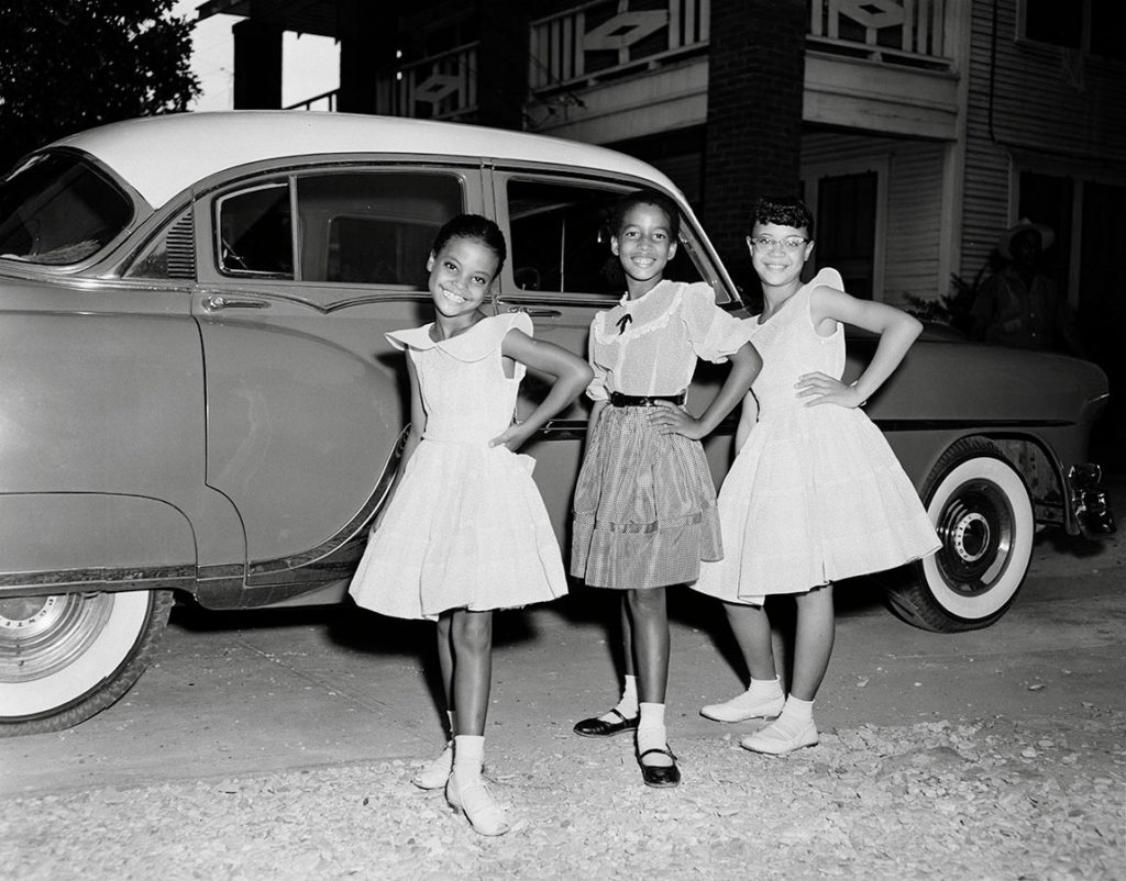 Girls posing in front of an automobile, Dallas, Texas, August 29, 1954. Photo by R. C. Hickman. e_rch_0194