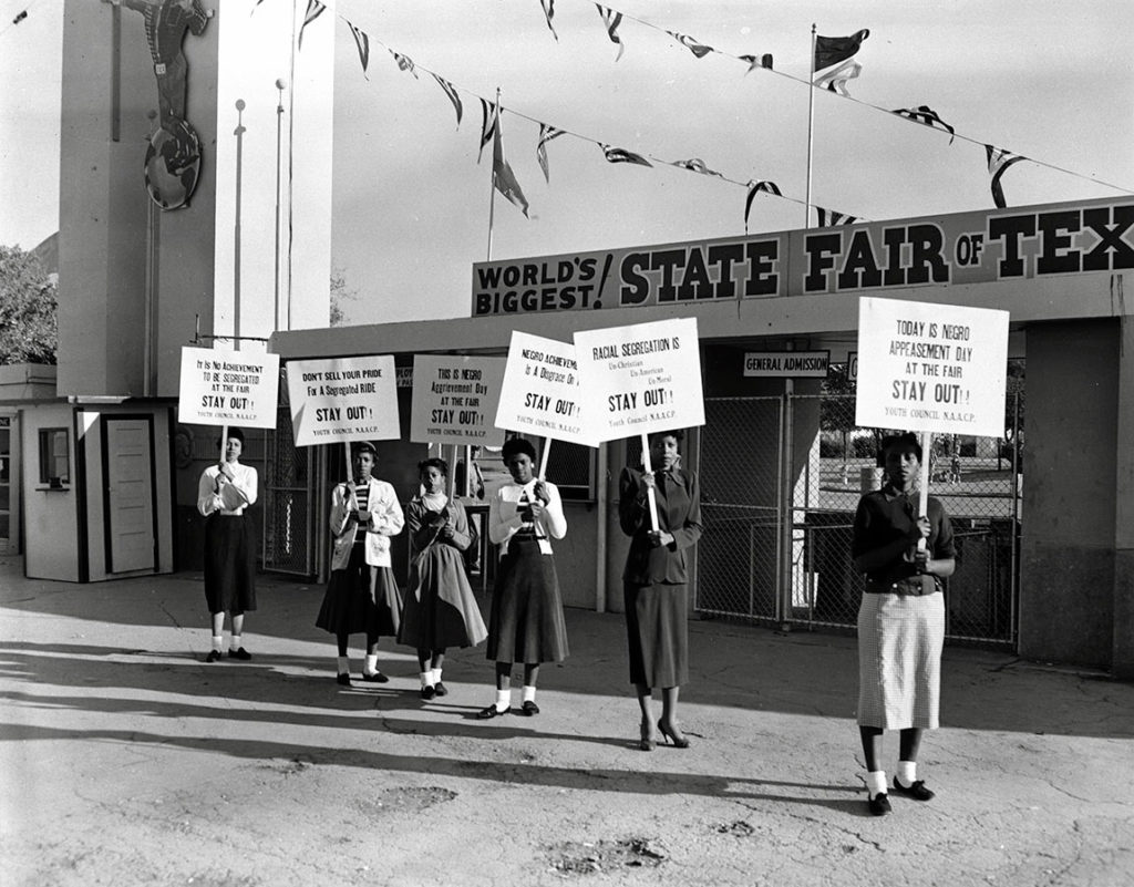 Young NAACP members protesting at the Texas State Fair in Dallas, Texas, October 17, 1955. Photo by R. C. Hickman. R. C. Hickman Photographic Archive. e_rch_0376