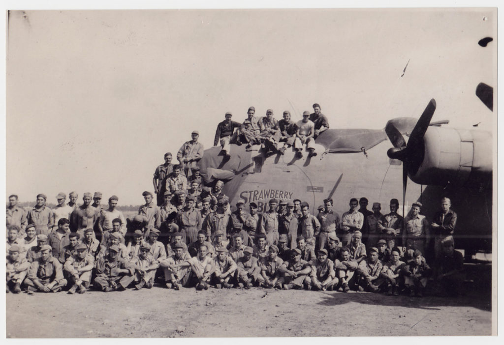 """U.S. Army Air Corps crew in front of """"Strawberry Bitch"""" bomber plane, ca. 1942–44. e_376th_0017"""