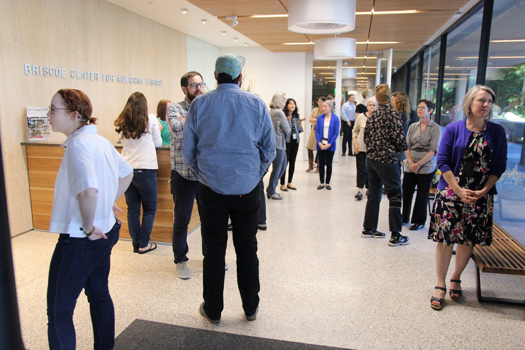 View from the Briscoe Center's entrance into the lobby with people.