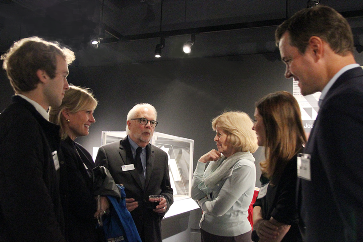 Don Carleton visits with a group of guests in the Briscoe Center's main exhibition gallery.