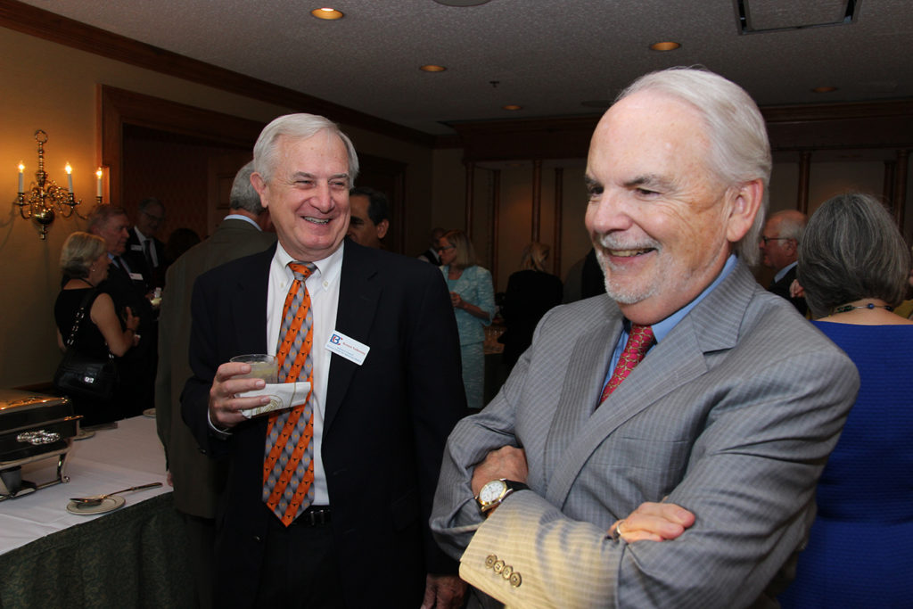 Ronnie Volkening and Don Carleton at an event. Both men are laughing.