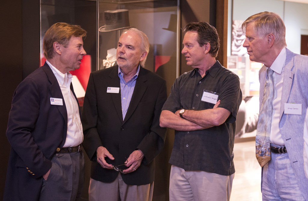 Mike Andrews visits with Don Carleton, Lawrence Wright, and Greg Curtis at a Briscoe Center event.