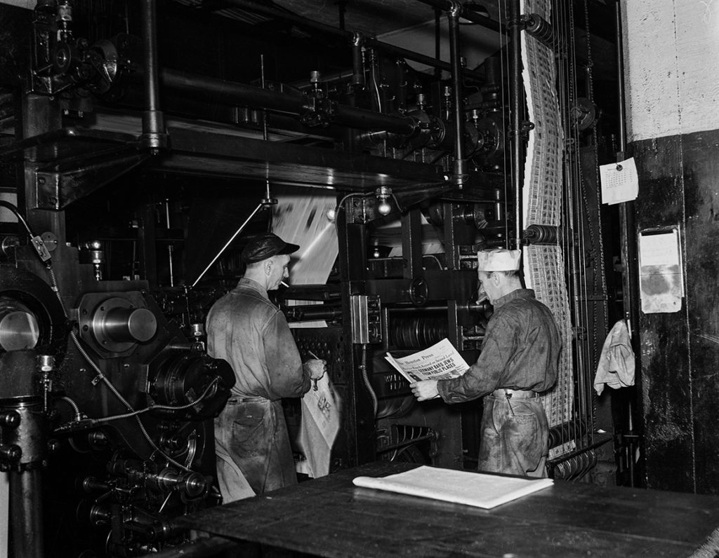 Newspaper printing press and employees, 1938. e_bb_3088