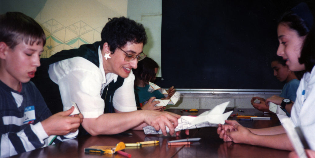 Student creasing their hexagons at the Hexaflexagon-Gifted Consortium, Fort Monmouth, New Jersey, 1994. e_math_00382