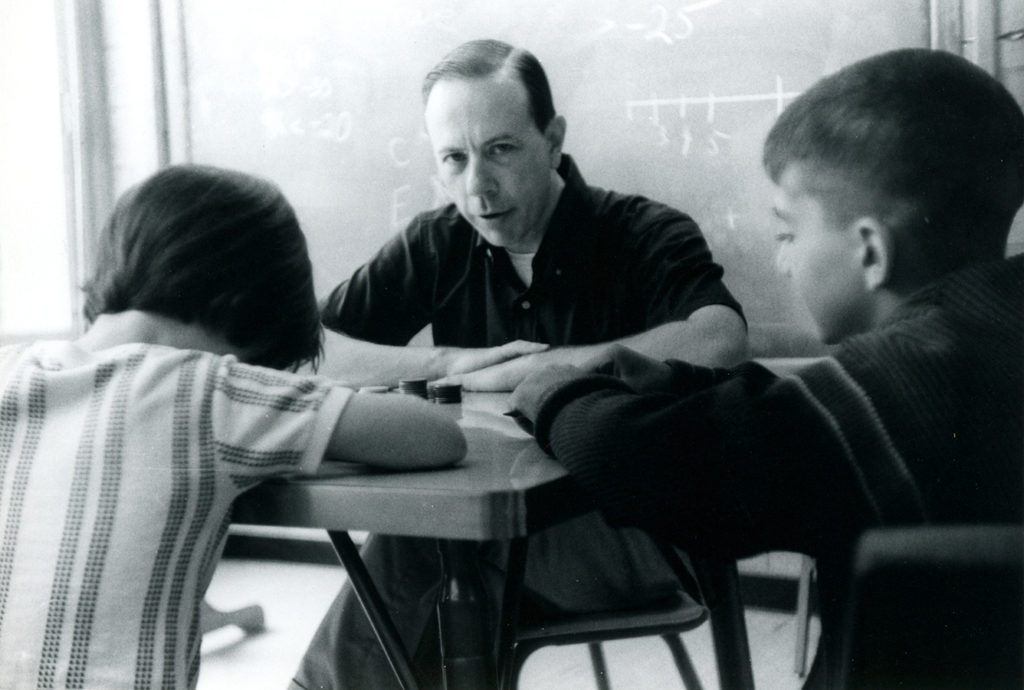 Andrew Gleason working with children, 1964. e_math_01153
