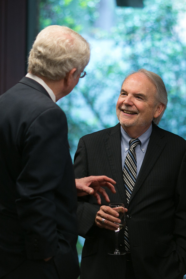 Don Carleton smiles while conversing with a guest.