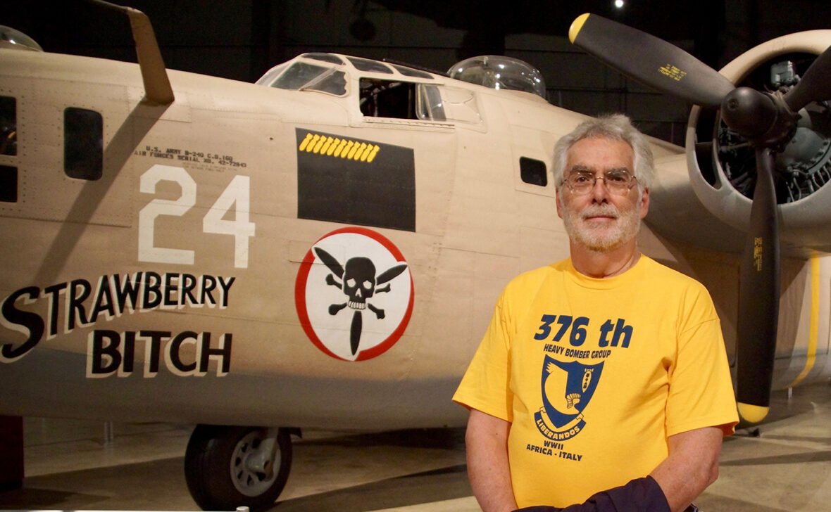 Ed Clendenin Jr. in front of his father's plane