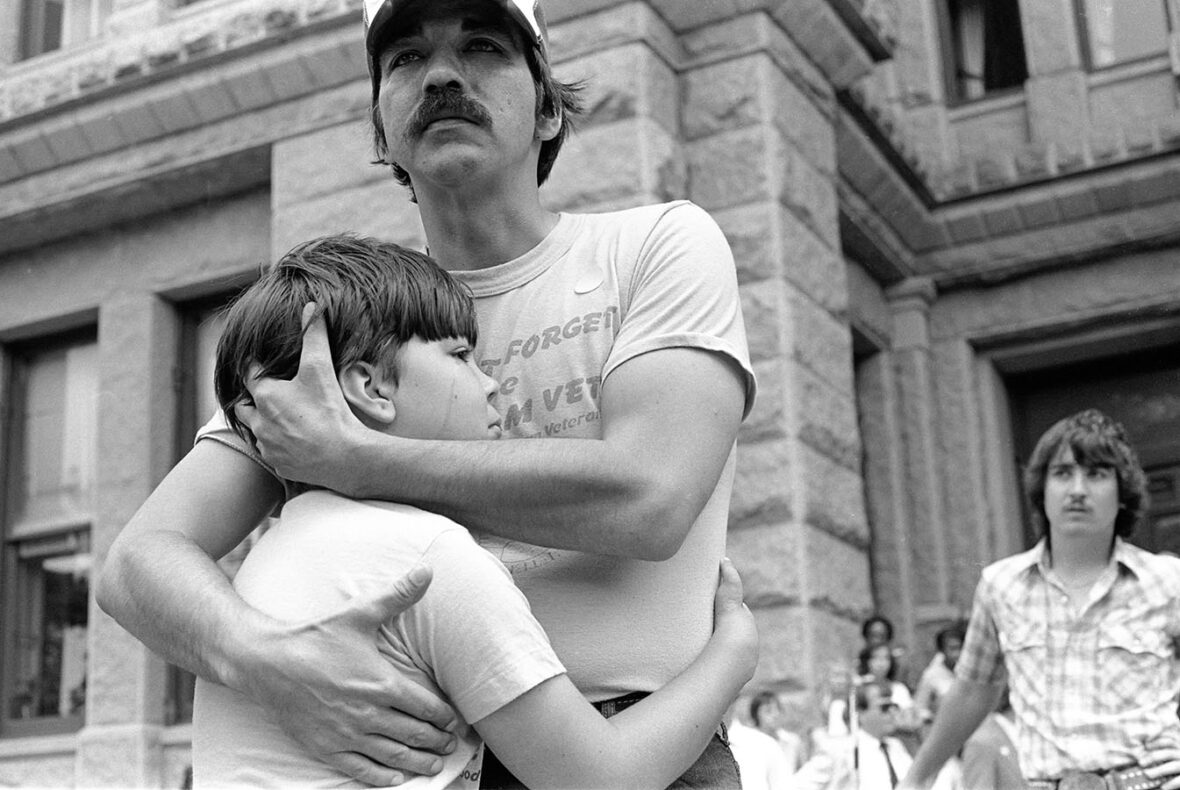 Vietnam Veteran Dan Jordan with his son Chad outside the Texas State Legislature building in Austin, Texas after a public speech he made at a rally to raise awareness about the health effects of exposure to Agent Orange, 1981. Photograph by Wendy Watriss. Frederick Baldwin and Wendy Watriss Collections. AO 417-4 (28)