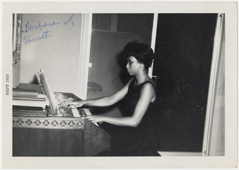Barbara Smith Conrad playing the organ, September 1959.