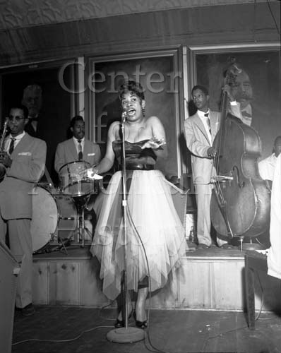 Ruth Brown singing with band at Masonic Mosque, Fort Worth, November 14, 1959. Calvin Littlejohn Photographic Archive. e_cl_0016