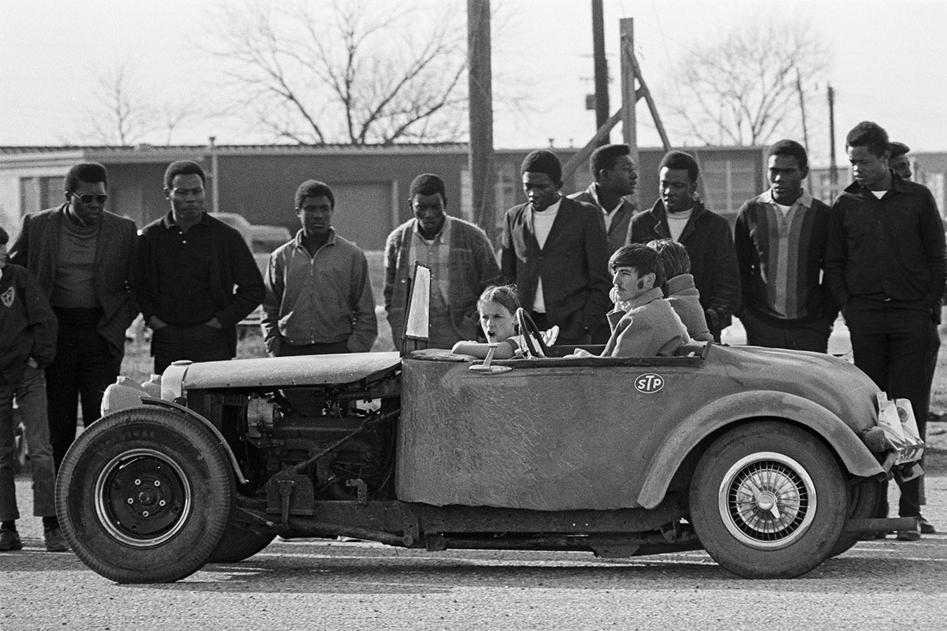 African-American spectators observing a drag race in Greenville, Mississippi, 1969. Photo by D. Gorton. White South Project Archive. e_wsp_0136